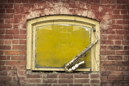 band bar: Jazz musical instrument saxophone with grungy street background