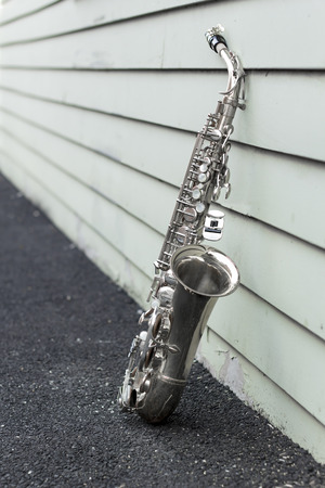 woodwind: Jazz musical instrument saxophone with grungy street background