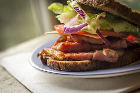 leftover: Leftover holiday ham sandwich with cheese and spicy honey mustard Stock Photo