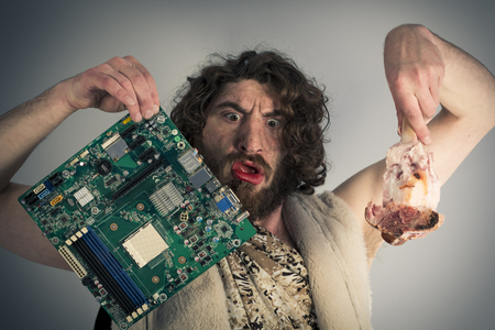 Silly confused caveman chooses between food and modern technology