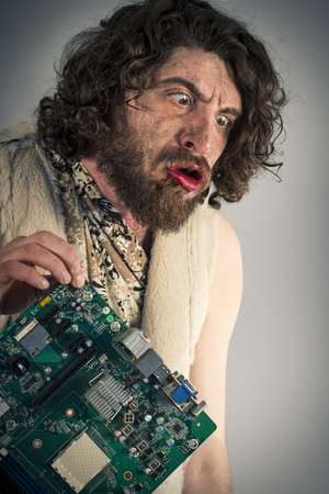 stoneage: Silly grunting caveman confused by modern computer technology