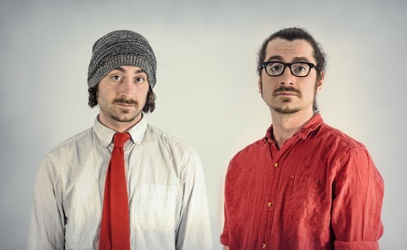 Twin adult men with beards take serious portrait Stock Photo