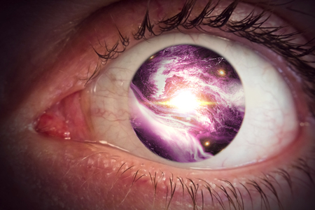 Giant eyeball backdrop with colorful space clouds universe pupil