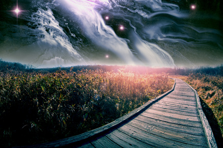 star path: Wooden path through field with majestic star scape Stock Photo