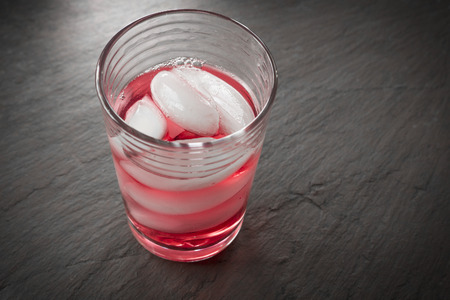 cranberry juice: Fresh cranberry juice in small glass with ice rustic