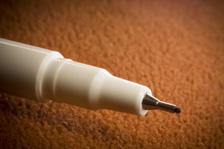 Close up macro ball point pen on orange background Reklamní fotografie