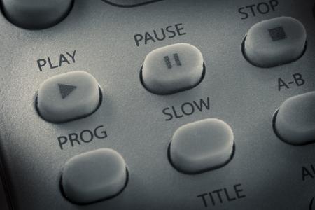 Macro cerca botón de reproducción mando a distancia y otros botones Foto de archivo