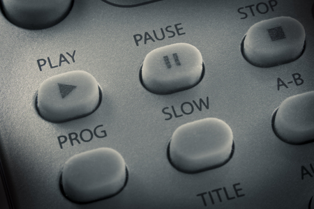 Macro close up remote control play button and other buttons Stock Photo