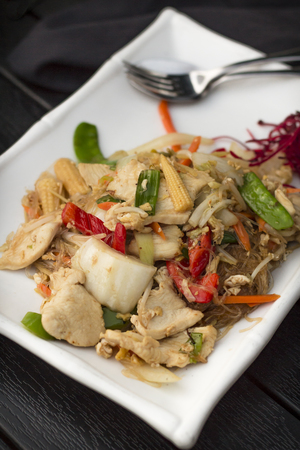baby rice: Spicy Thai dinner dish Pad woon sen chicken with mixed vegetables