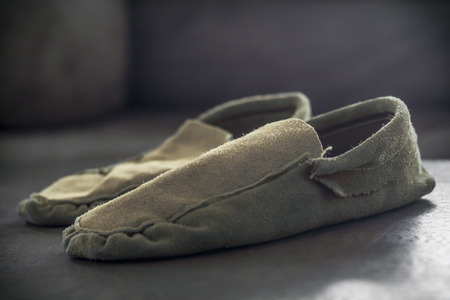 moccasins: Authentic Native American Indian gathered toe moccasins on rustic wood Stock Photo