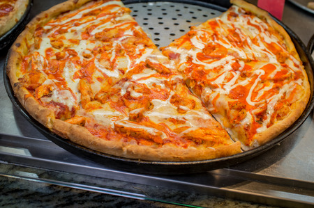 Large slices of buffalo chicken pizza New York pizzeria restaurant style