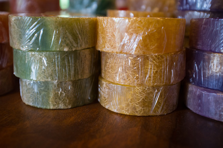 bar of soap: Rows of colorful homemade bar soap on wooden table
