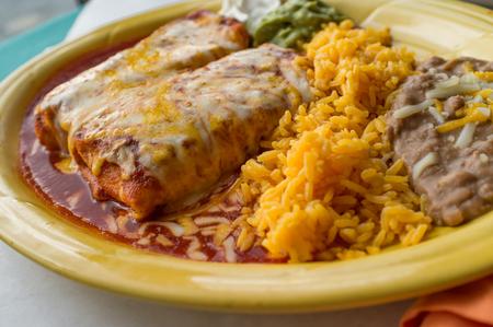 Authentic Mexican chimichanga burrito with sour cream jalapeno and cilantro