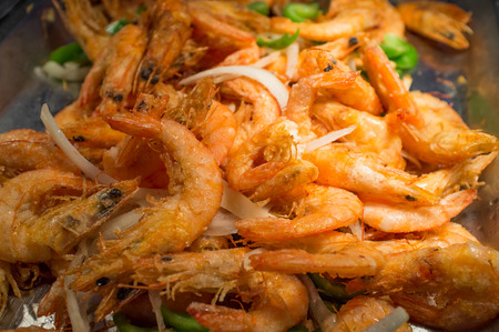 Fried whole heads on shrimp breaded and crispy in buffet tray