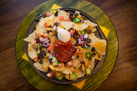 loaded: Vegetarian nachos loaded with toppings like jalapeno and black olives