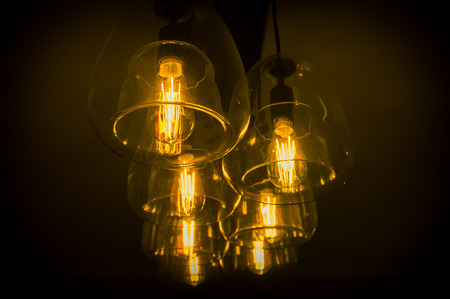 chandelier background: Decorative antique edison style light bulbs chandelier background Stock Photo