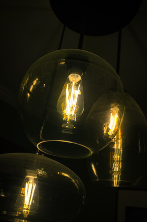 chandelier background: Decorative antique edison style light bulbs chandelier background Stock Photo