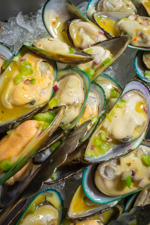 seasoned: Pile of fresh seasoned mussel shellfish served cold on ice