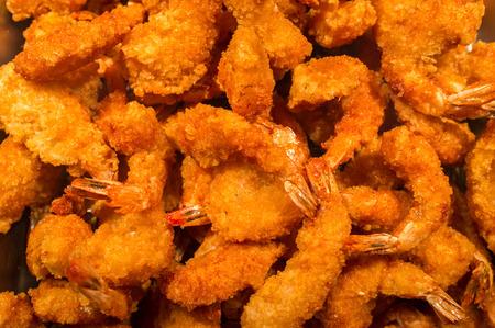 Large pile of popcorn shrimp tempura in buffet tray