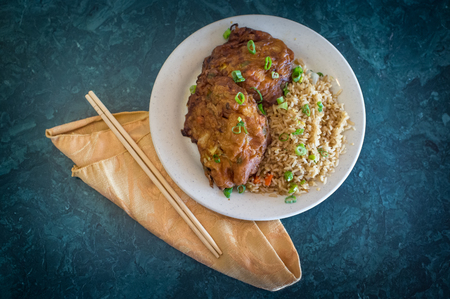yat: Chinese egg fu yung omelette with fried rice at restaurant Stock Photo