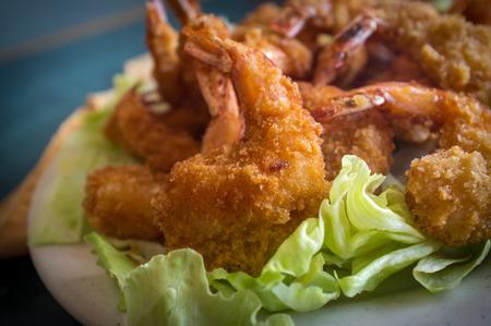 Large serving of popcorn shrimp tempura appetizer on bed of lettuce