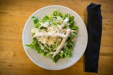 Fresh organic caesar salad with grated asiago cheese