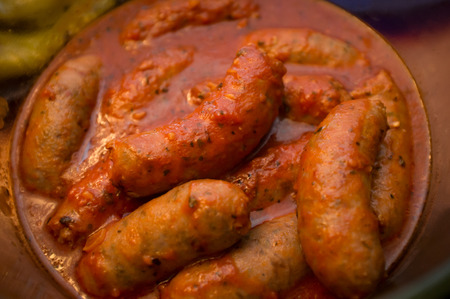 Closeup homemade Italian sausage in red tomato sauce