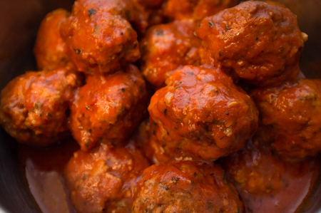 Closeup homemade Italian meatballs in red tomato sauce Stock Photo