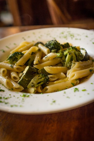 wine sauce: Vegetarian penne primavera with white wine sauce and green vegetables