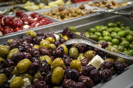 olive green: Close up of fresh Italian olive bar self serve