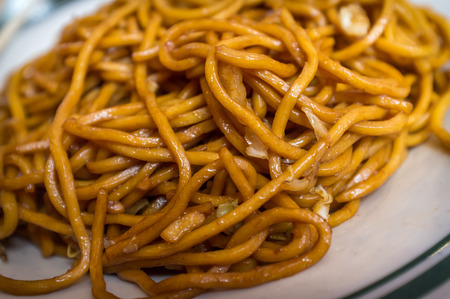 lo mein: Chinese food vegetable plain lo mein noodles at restaurant