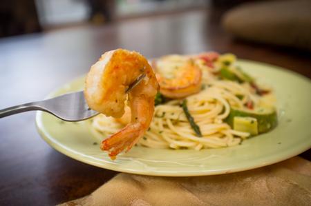 primavera: Shrimp spaghetti primavera with white wine sauce and green vegetables