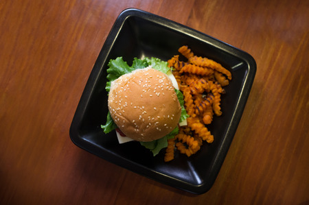 crinkle: Cheeseburger on a whole wheat bun with crinkle cut sweet potato fries