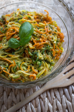 spiralized: Colorful spiralized vegetable pasta with pesto sauce