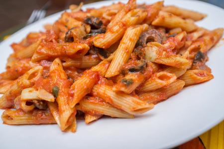 puttanesca: Primavera vegetable penne with Italian puttanesca spaghetti sauce