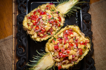 Fancy sweet whole pineapple half salsa South American appetizer