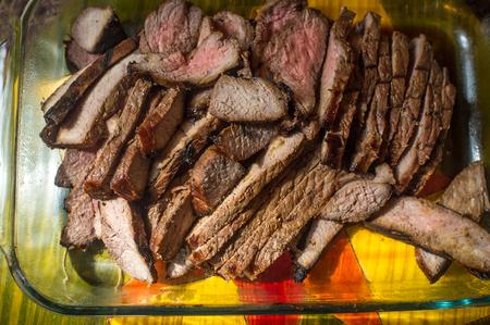 Sliced juicy medium rare skirt steak is serving tray Reklamní fotografie