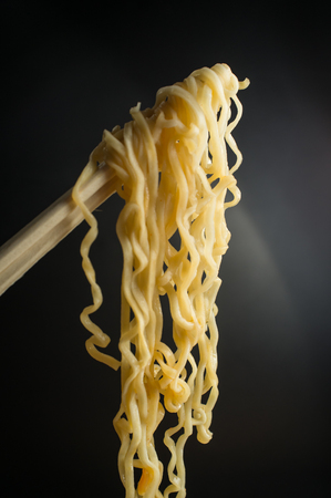 Spicy asian ramen noodle soup with chopsticks Imagens - 60727259