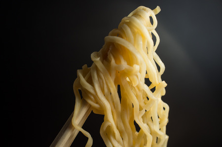 Spicy asian ramen noodle soup with chopsticks Imagens - 60727264