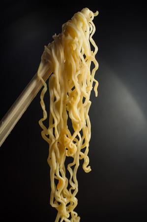 Spicy asian ramen noodle soup with chopsticks Imagens - 60727268