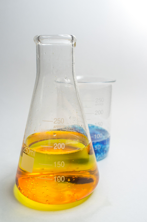 Close up glass measuring beaker for science experiment background Stock Photo