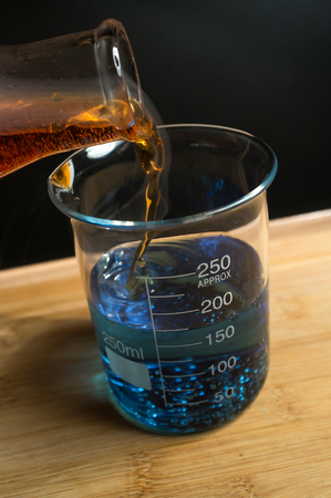 milliliters: Close up glass measuring beaker for science experiment background Stock Photo