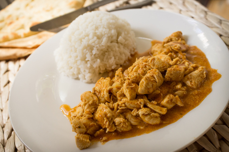 Authentic Indian cuisine Tikka Masala served with jasmin rice Stock Photo