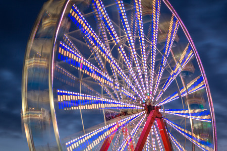 timelapse: Summer carnival ferris wheel at night with light blur time lapse