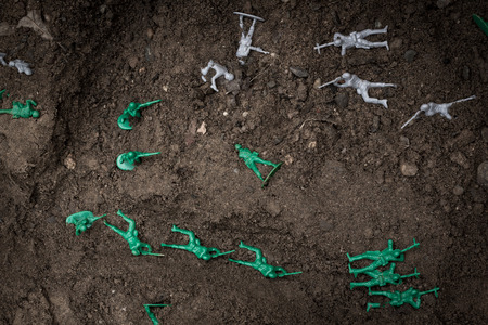 trenches: Green toy soldiers in the dirt defending the trenches Stock Photo