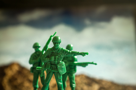 mountaintops: Green toy soldiers with mountaintops the lookout points the way