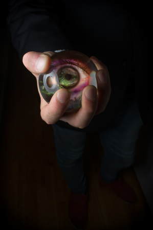 eye ball: Holding third eye in fortune teller magic crystal ball