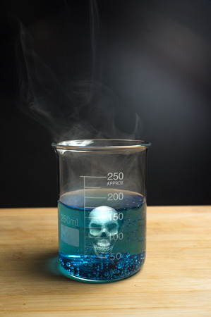 metodo cientifico: Close up glass measuring beaker with poison skull