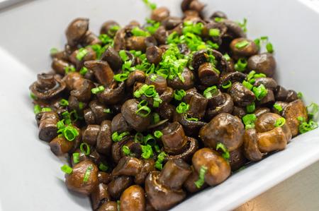 green onion: Sauteed fresh crimini mushrooms topped with green onion garnish
