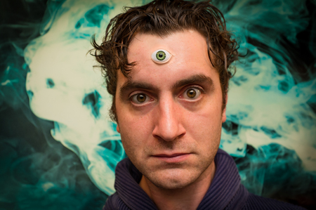 Handsome male fortune teller with magic third eye Stock Photo